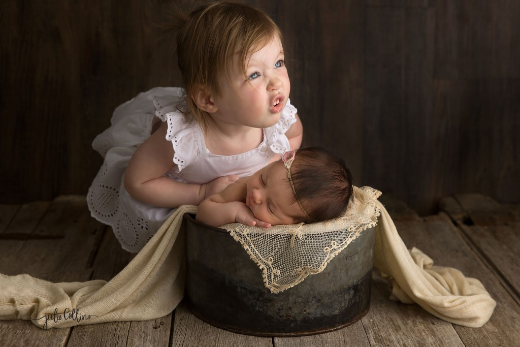 Big sister pose with newborn Wisconsin photographer