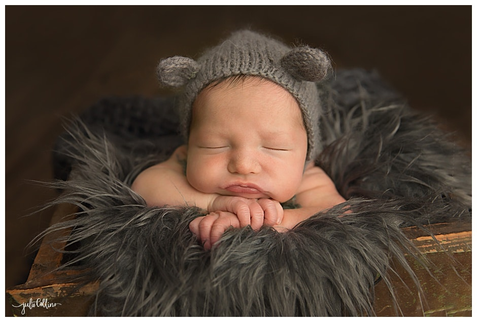 Newborn boy with bear hat