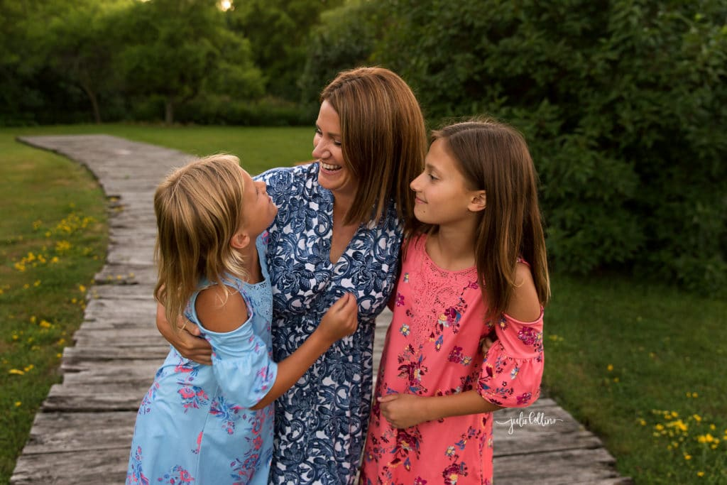 Mom with two daughters looking at each other