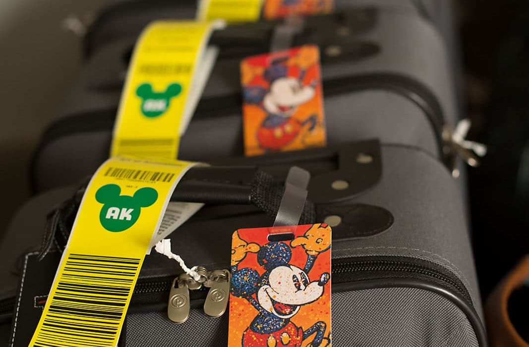Child suitcases all lined up with Disney tags