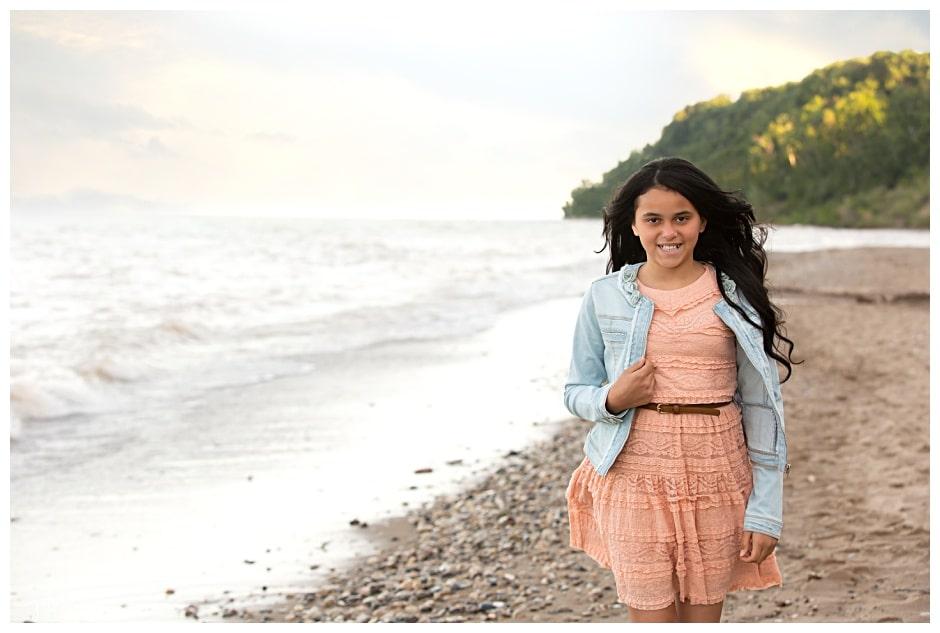 Young girl on beach hurricane survivor