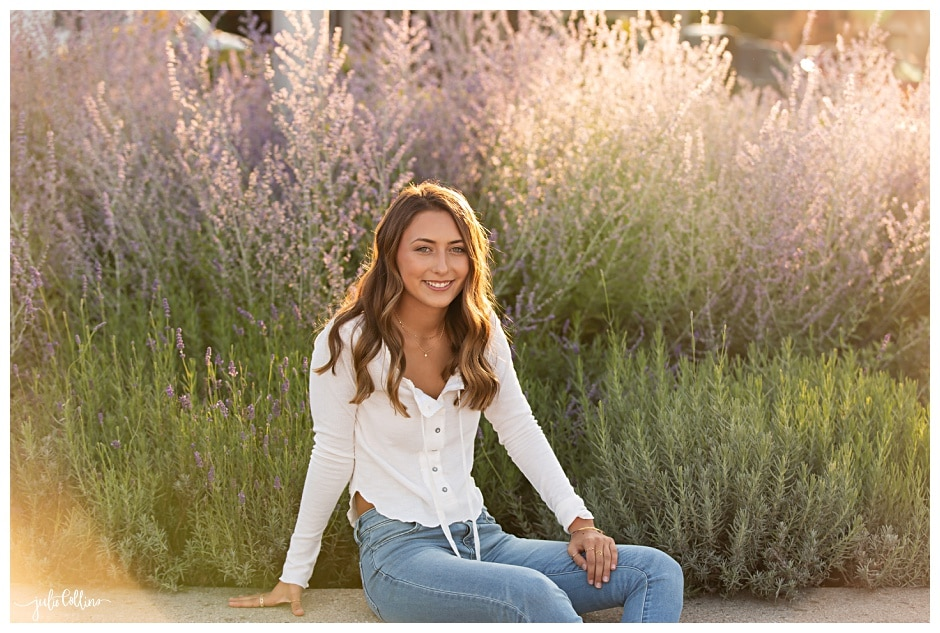 Senior girl sitting by lavendar
