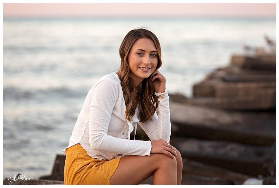 Senior girl on pier Lake Michigan