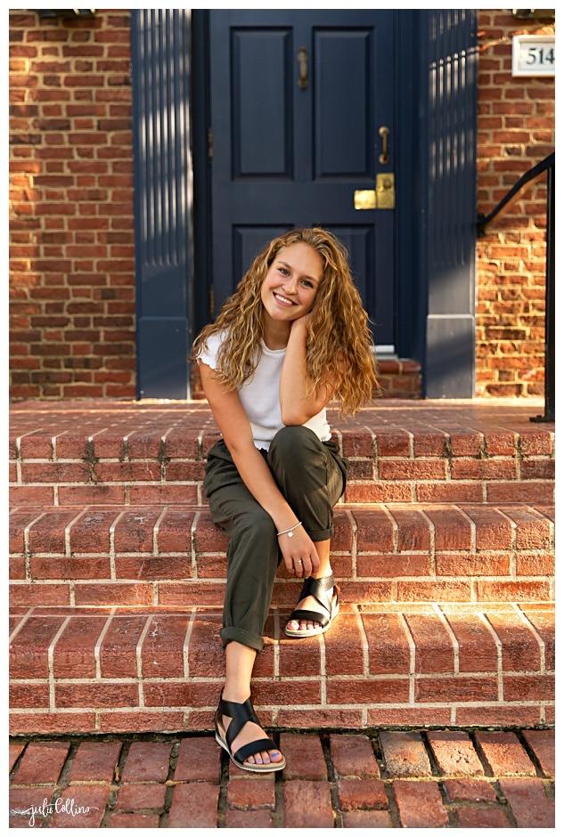 High school senior girl on steps in urban setting
