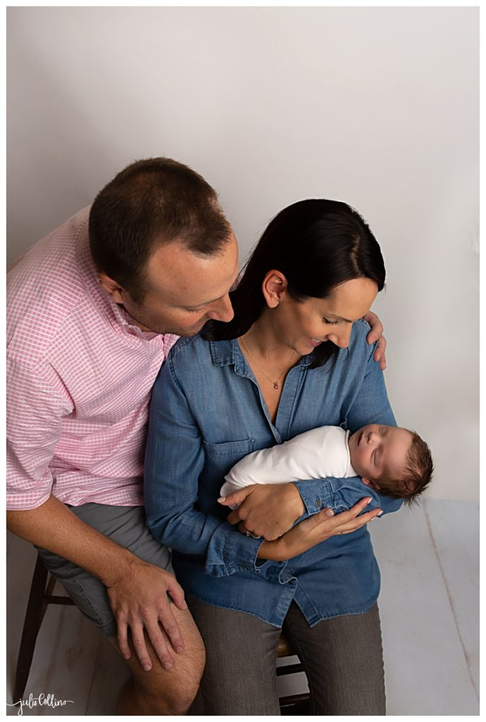 Newborn baby boy posed with mom and dad