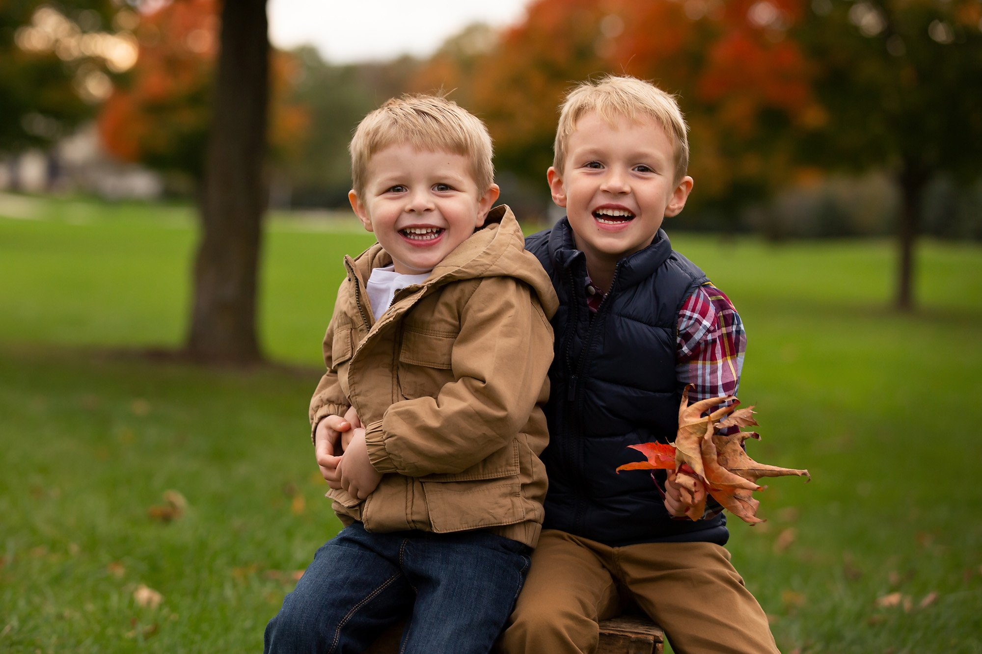 Little boys smile during a family session with Julie Collins Photography