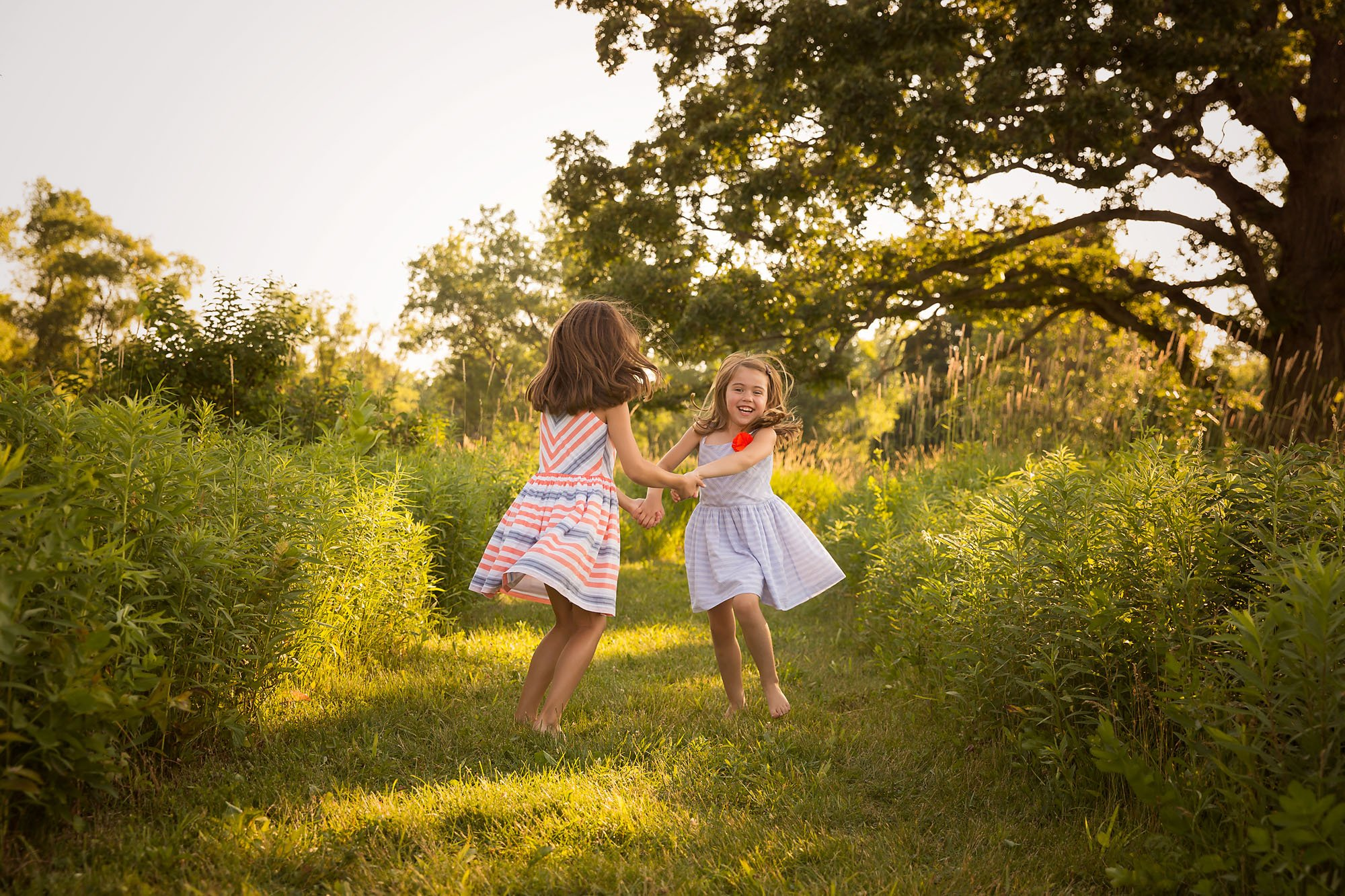 little girls twirling during a family session with Julie Collins Photography