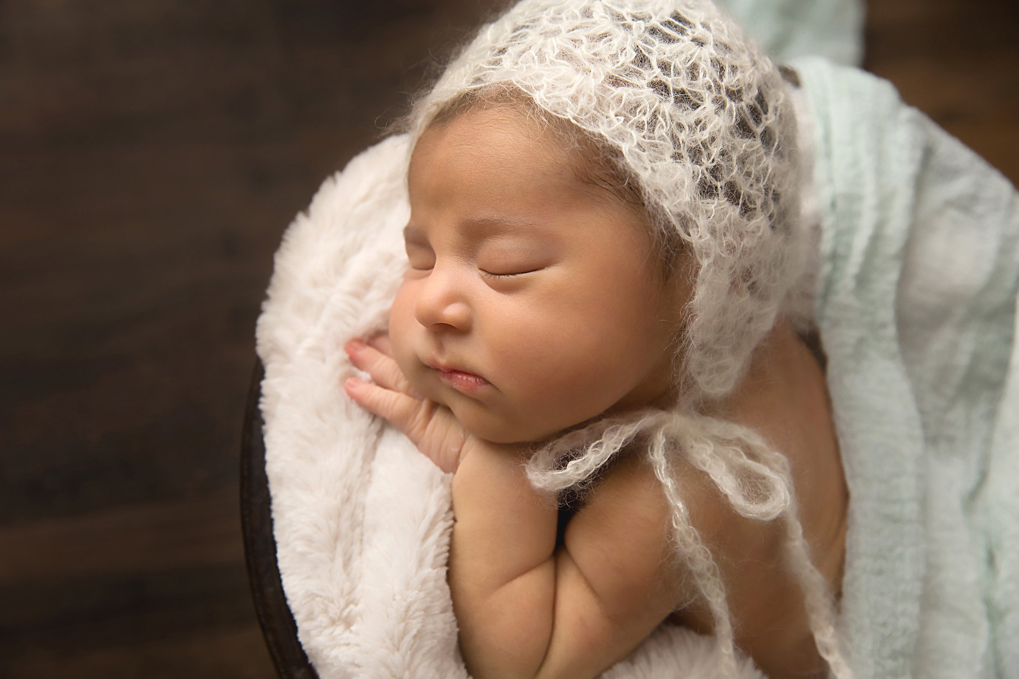 Newborn baby girl sleeping during a newborn portraits session with Julie Collins Photography