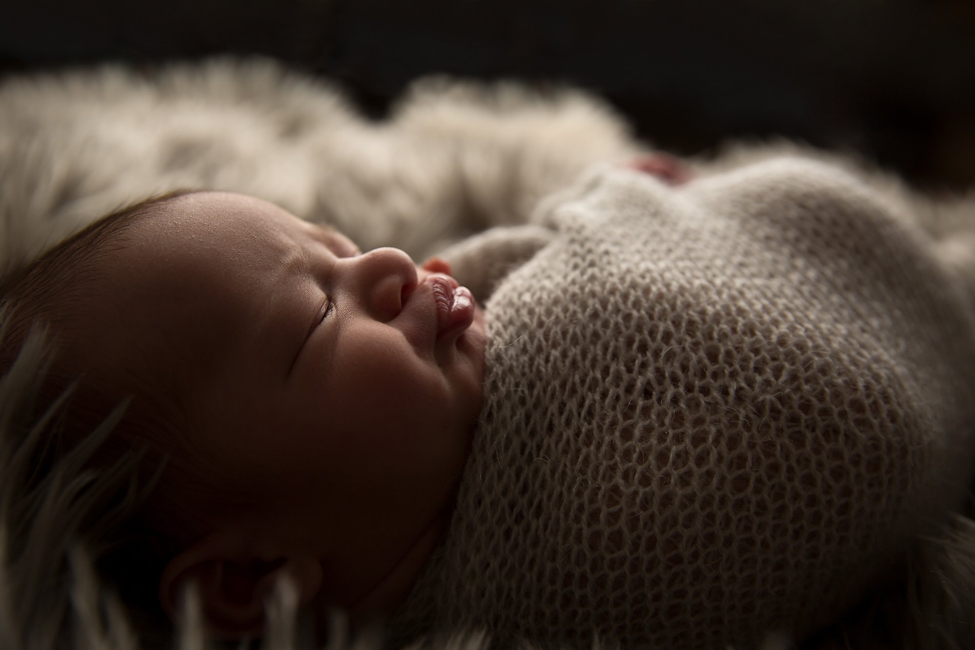 Closeup of Newborn baby with puckered lips by Julie Collins Photography