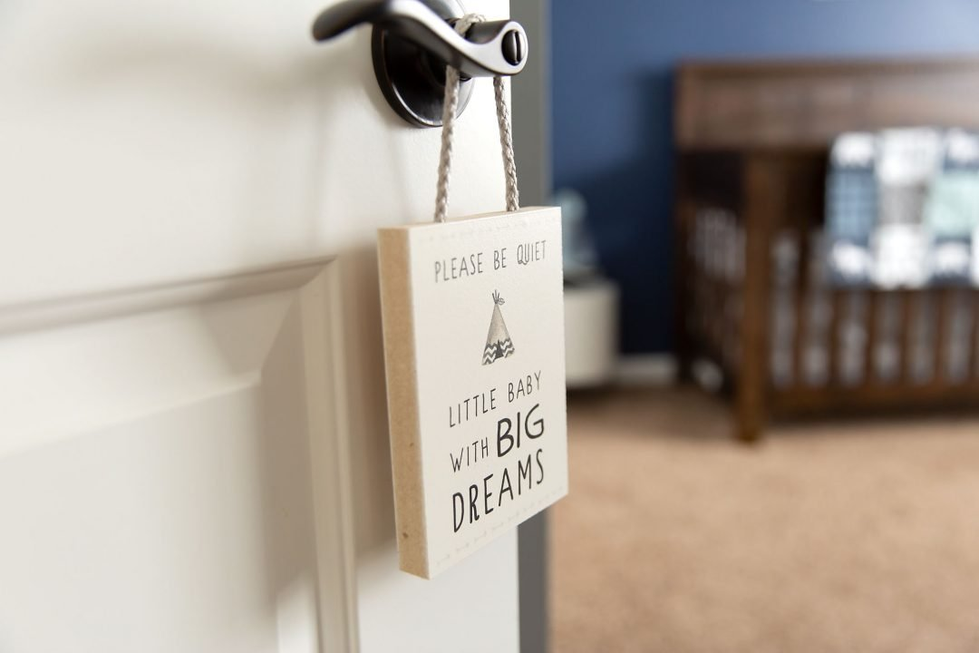 "Wooden sign hanging on door that says, ""Please Be Quiet, little baby with big dreams"""