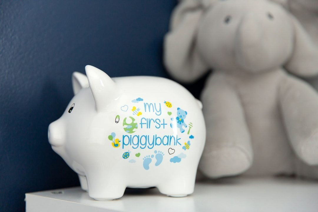 Close up picture of a piggy bank in baby's nursery
