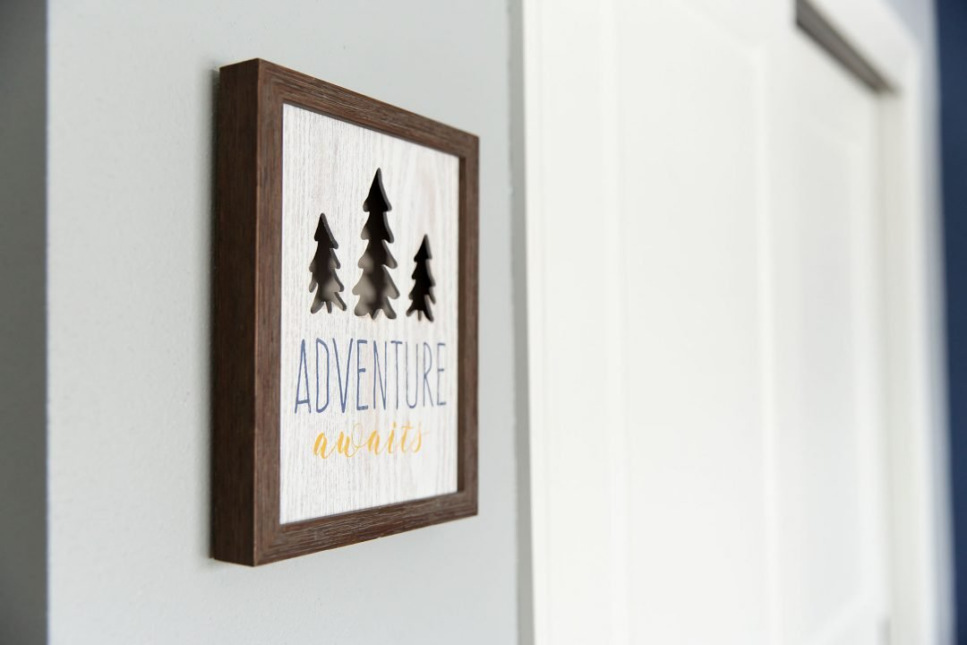 Picture says Adventure Awaits in newborn nursery