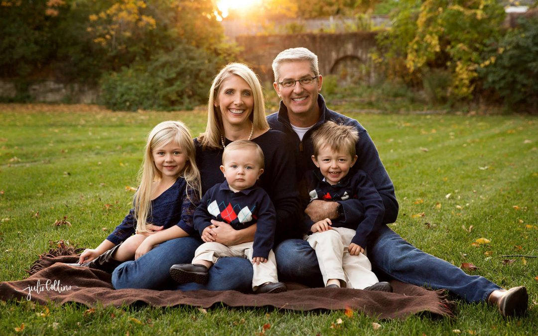 Family of five sitting in grassy field in Milwaukee