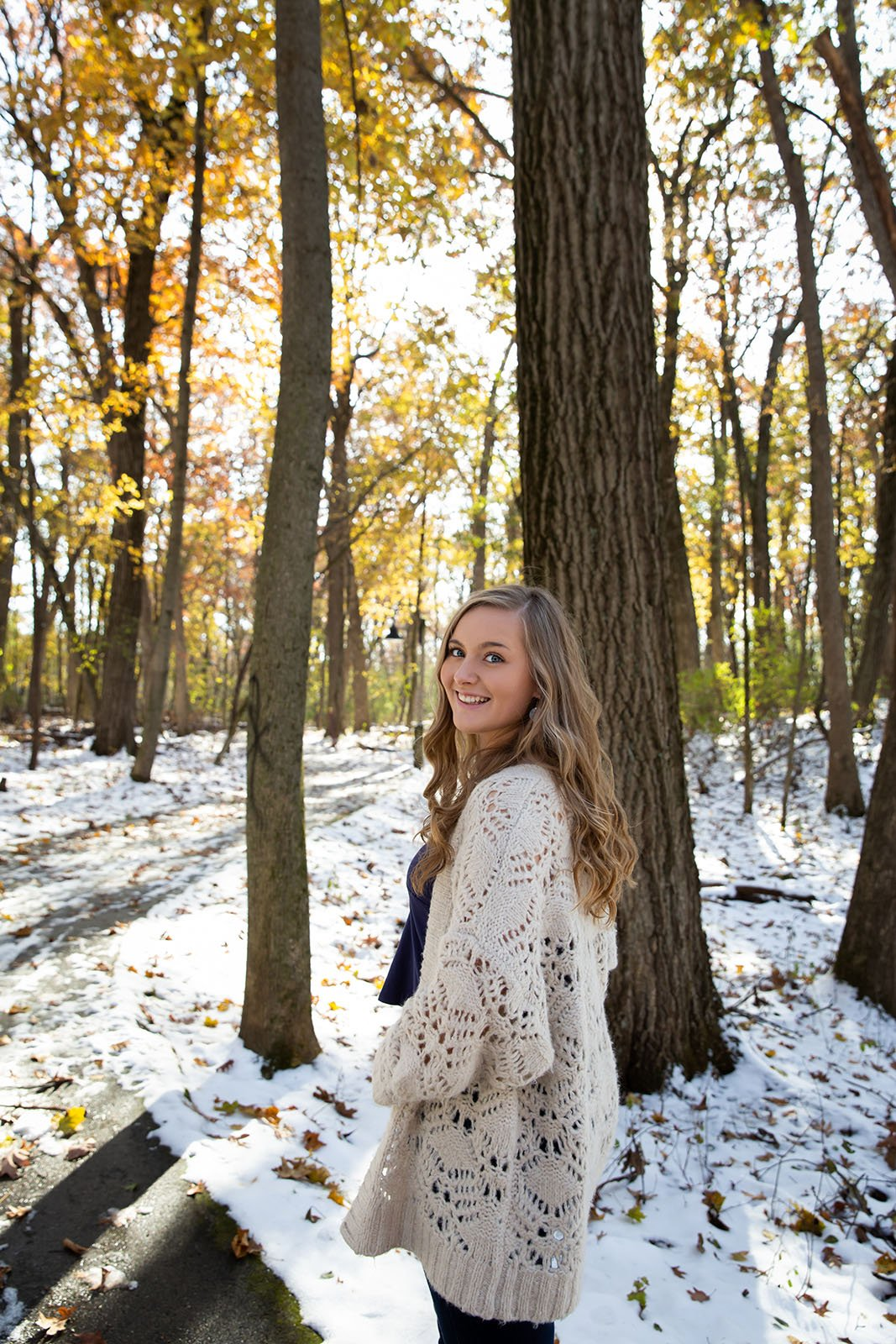 Oconomowoc High School senior girl smiling at her senior picture session at Nagawaukee, Delafield