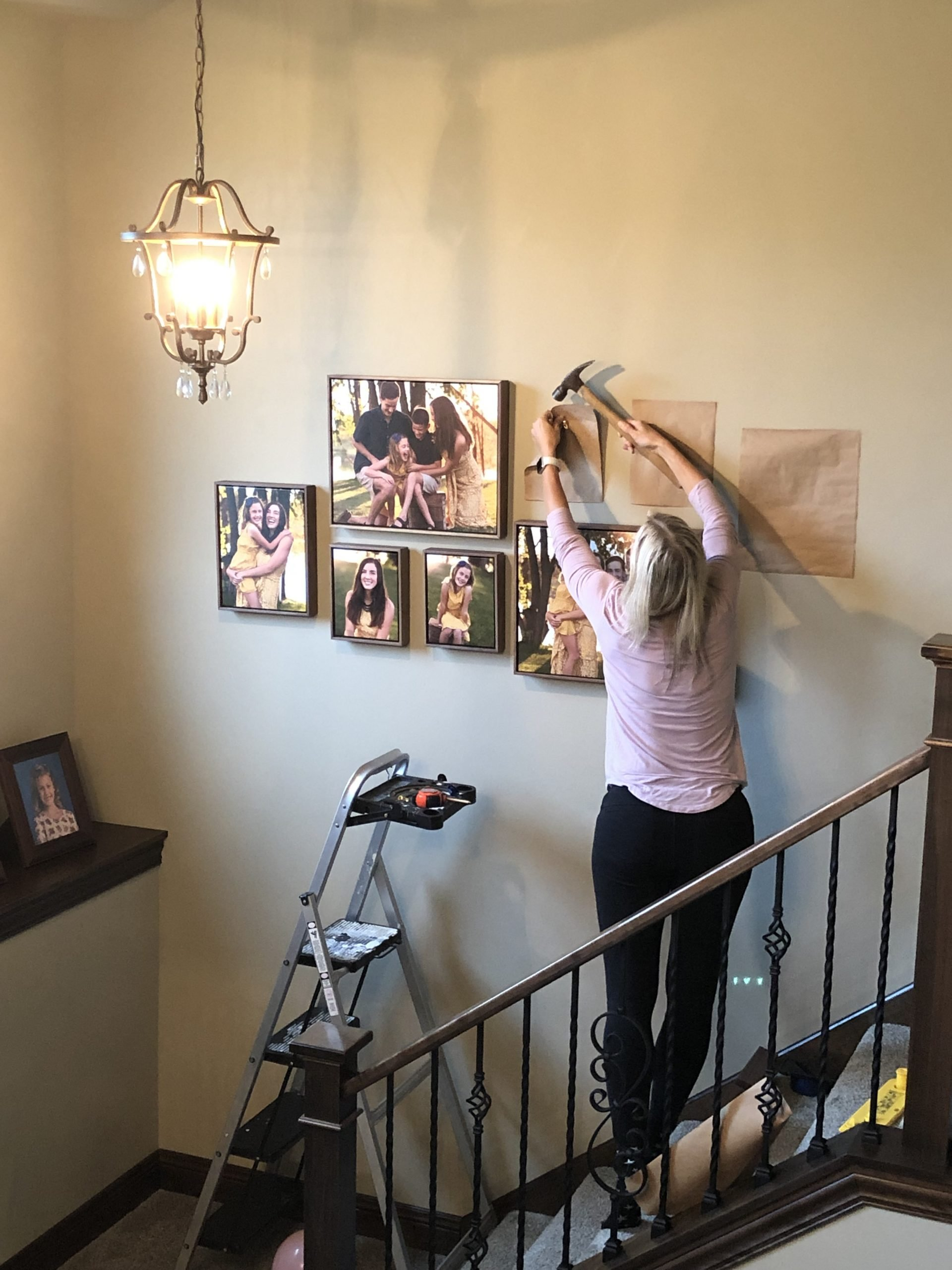 Julie Collins Photography creating a gallery wall in Delafield, WI