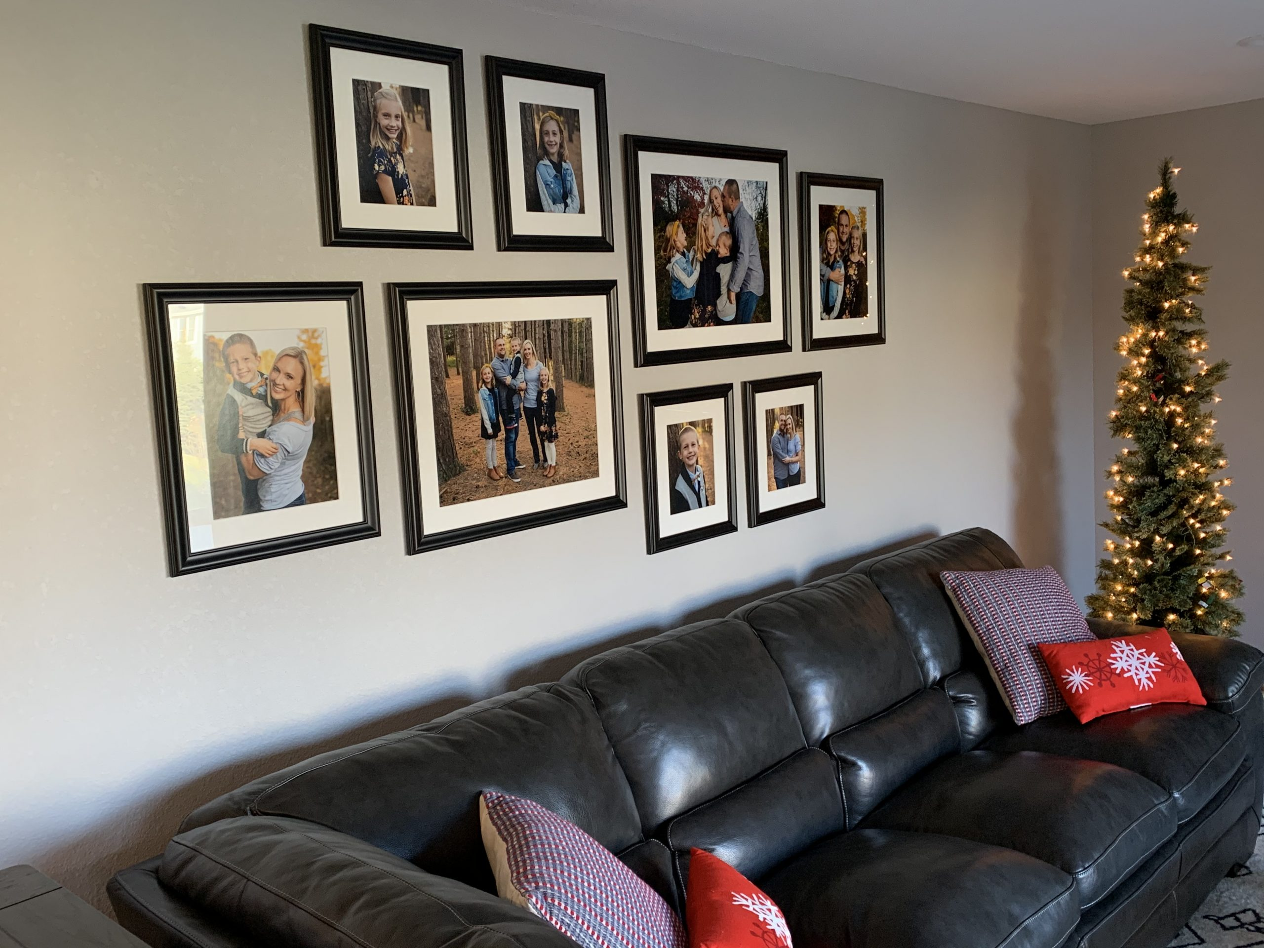 Family portrait wall art displayed in eigh framed pieces