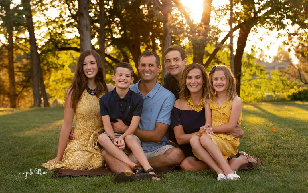 Family of six sitting for portraits in their backyard in Oconomowoc, Wisconsin