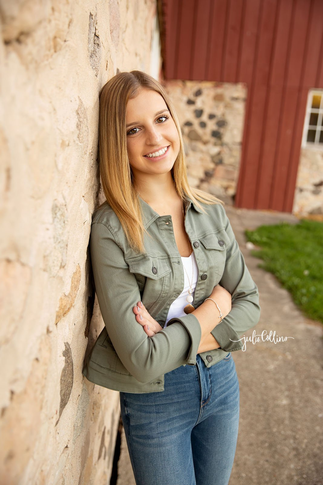 Hartland Arrowhead Senior girl smiling for camera during senior portrait session in Delafield, Wisconsin