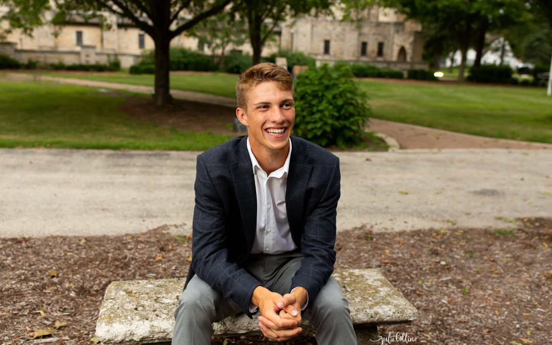 High school senior boy posing for pictures at St. John's Military Academy in Delafield, Wisconsin