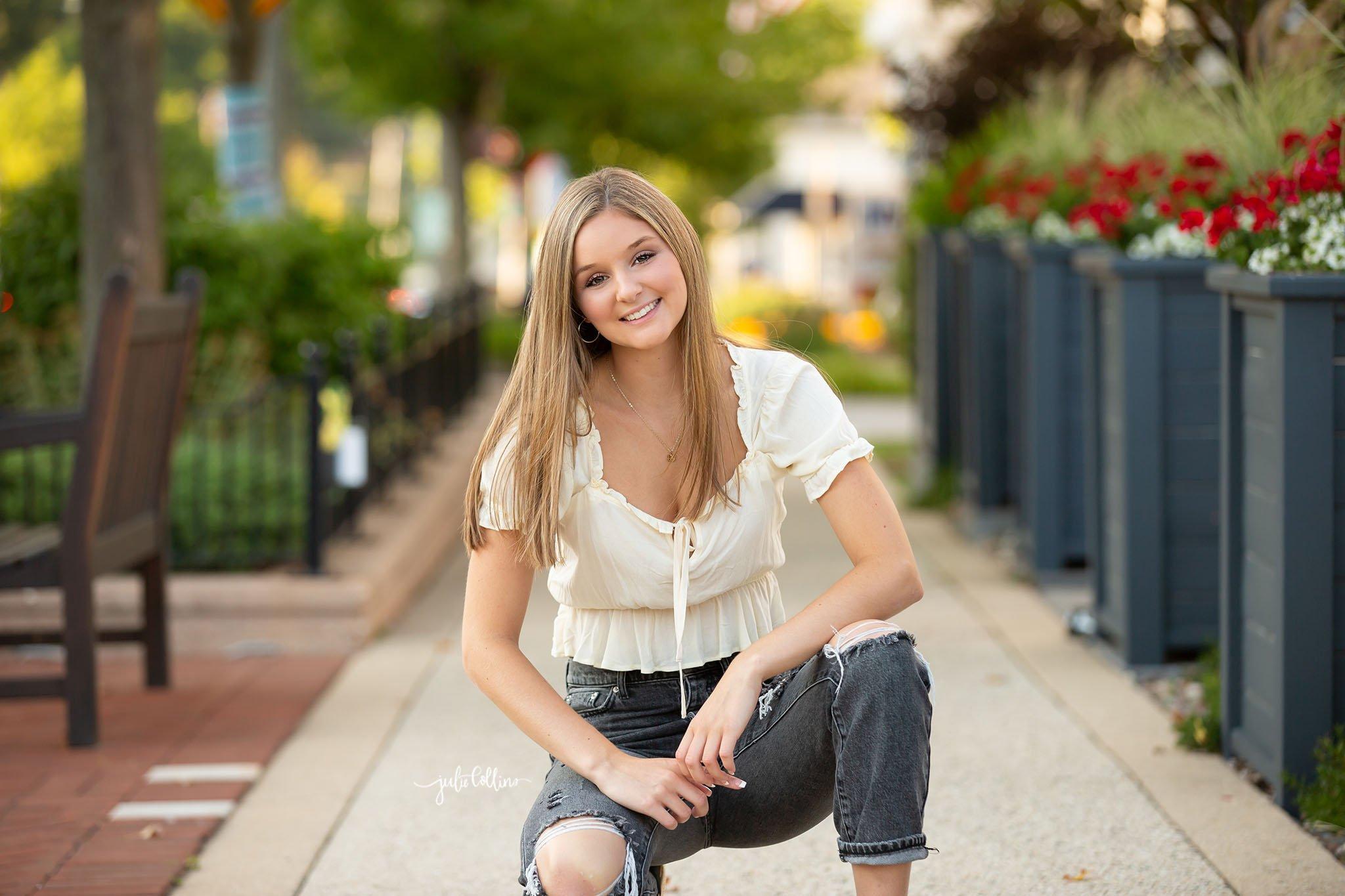 Oconomowoc senior girl smiling for camera at her senior picture session in Delafield, Wisconsin