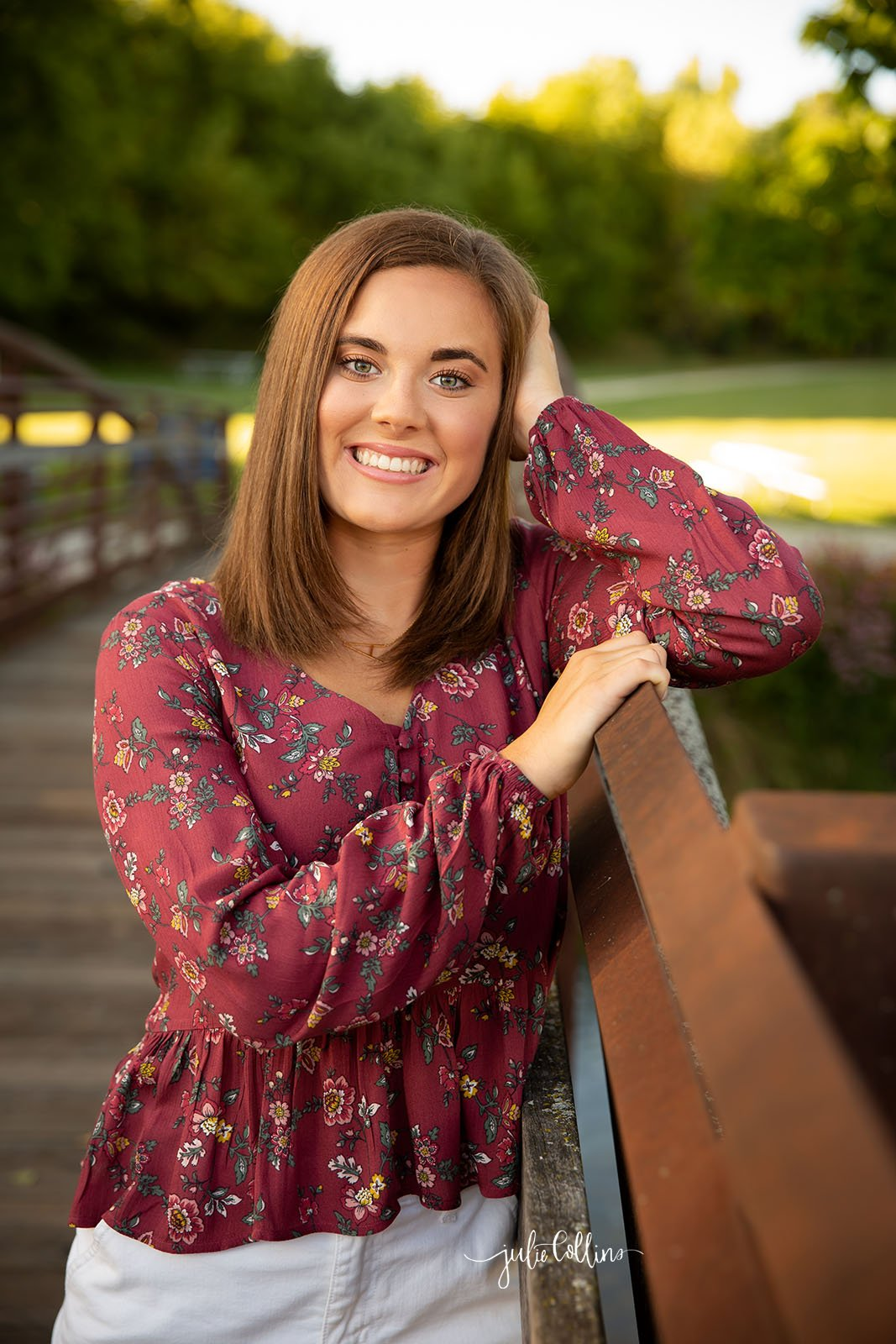 Senior in high school girl smiling for camera at their portrait session in Delafield, Wisconsin